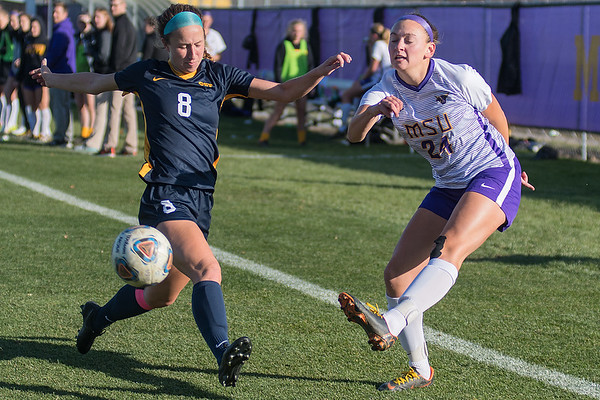 Molly Sarafolean of Minnesota State (right) crosses the ball in front of Concordia-St. Paul defender Hannah Pavek in the first half of Wednesday's NSIC tournament game. Photo by Jackson Forderer