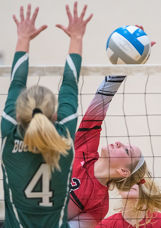 St. Clair's Megan Devens (right) hits a spike while Waterville-Elysian-Morristown's MaeLea Harmon attempts to block it during Thursday's sub-section championship match.Photo by Jackson Forderer
