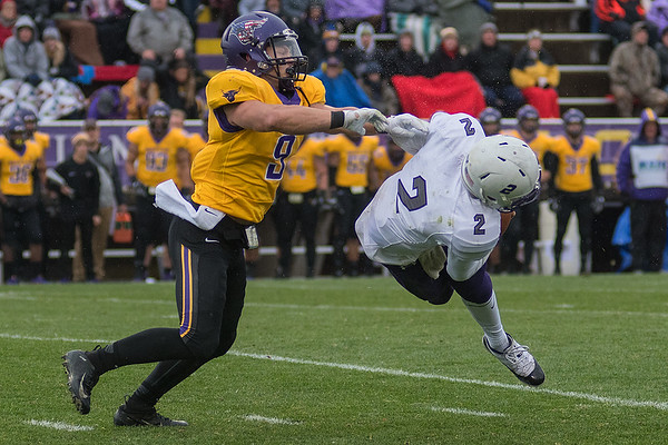 Minnesota State's Michael Palme (left) sacks University of Sioux Falls quarterback Caden Walters on a blind side blitz in the third quarter. Photo by Jackson Forderer