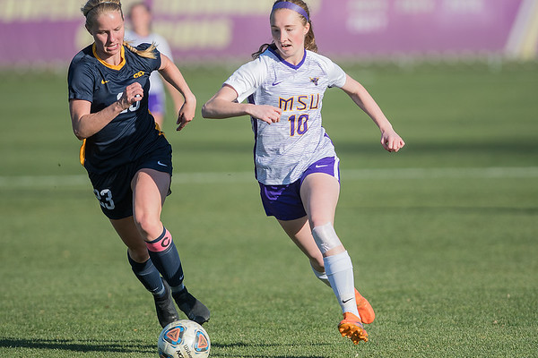Minnesota State's Brynn Desens (right) tries to outpace Concordia-St. Paul's Jordan Rowan-Stafford to get to the ball in the first half of Wednesday's NSIC playoff game. Photo by Jackson Forderer
