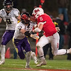 Mankato West's Wyatt Block gives a stiff arm to Chaska's Grif Wurtz in the second half of Friday's game. The Scarlets lost to Chaska 17-13. Photo by Jackson Forderer