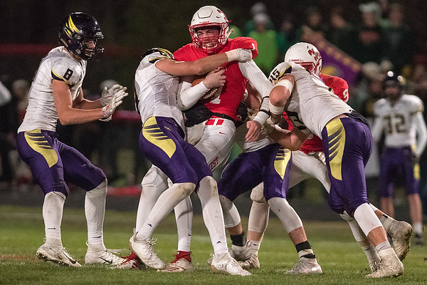 Mankato West's Jack Foster is stood up by the Chaska defense on a fourth down play in the second half. The Scalets fell one game short of going to state in their 17-13 loss to the Hawks. Photo by Jackson Forderer