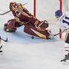 University of Minnesota goalie Eric Schierhorn gets just enough of his pad blocker on the puck to deny Minnesota State's Jared Spoon a goal in the third period. The Mavericks won the game 2-1 to sweep the series against the rival Gophers. Photo by Jackson Forderer