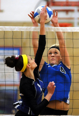 John Cross <br /> McKenzie Schaffer of LCWM blocks a tip from MCW's Hailey Leiding 2A sub-section action at West High School on Thursday.