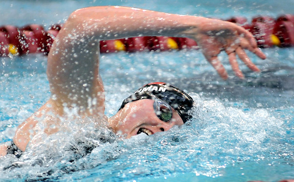 Mankato West's Nicole Lohman swims a leg of the 400 yard freestyle relay during the State Class A swim meet Saturday at the University of Minnesota Aquatic Center. Lohman and her teammates Chantal and Danielle Nack and Madison Bacon won the event.