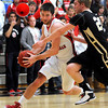Bethany Lutheran College's Alex Weldon drives around St. Olaf's Michael Jenson during the first half Thursday.