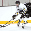 Gustavus Adolphus College's Joey Olson keeps University of St. Thomas' Anthony Moser away from the puck during the first period Friday at Don Roberts Ice Rink.