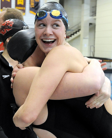 Mankato West's Danielle Nack gets a hug after setting a Minnesota all-time record in the 100 yard butterfly during Saturday's State Class A swimming and diving meet at the University of Minnesota Aquatic Center.