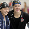 Sisters Chantal (left) and Danielle Nack are congratulated after winning Class A championships Saturday at the University of Minnesota Aquatic Center. Chantal won the State Class A championship in the 200 freestyle and her sister Danielle won the 50 freestyle, beating her Class A record from last year.