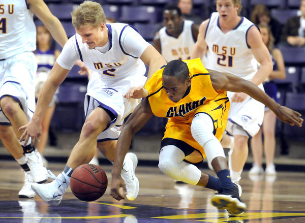 Pat Christman<br /> Minnesota State's Grant Pope and Clarke's Tre Wagner scramble for a loose ball during the first half Tuesday at Bresnan Arena.