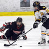 Pat Christman<br /> Rochester John Marshall's Mallory Adamson tips the puck away from Mankato East/Loyola's Tatum Schulz during the first period Saturday at All Seasons Arena.