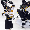 Pat Christman<br /> Mankato East/Loyola's Amanda Broman celebrates a goal during the team's home opener against Faribault Thursday at All Seasons Arena.