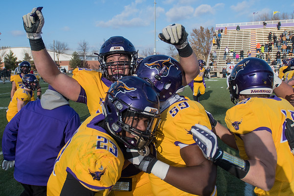 Minnesota State players including Evan Perrizo (top), Randy Jones (59) and Nate Gunn (23) celebrate after defeating Colorado State-Pueblo in overtime 16-13 at Blakeslee Stadium on Saturday. CSU-Pueblo missed a field goal in overtime to prompt the celebration. Photo by Jackson Forderer