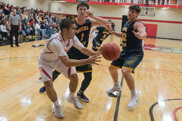 Bradley Rose of Bethany Lutheran passes the ball to his brother Brady Rose along the baseline in the Vikings home game against Buena Vista on Wednesday. The twin brothers from Le Sueur are seniors on this year's Vikings men's basketball team. Photo by Jackson Forderer