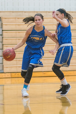 Loyola/Nicollet's Brooke Skrien (left) drives the baseline against teammate Marah Hulke during practice held in Nicollet on Wednesday. Photo by Jackson Forderer