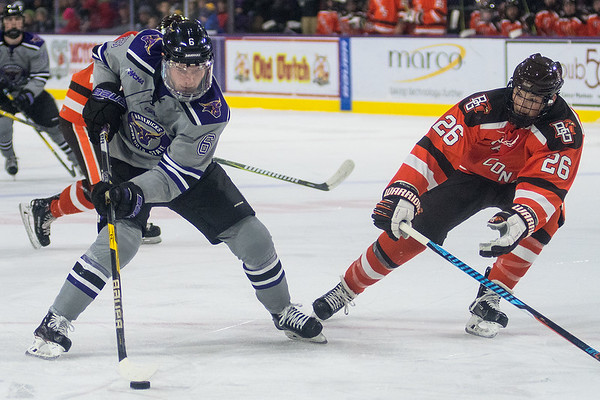 Parker Tuomie (left) of Minnesota State skates deep into the offensive zone while being defended by Bowling Green's Matt Meier (26) in the second period of Friday's game. Photo by Jackson Forderer