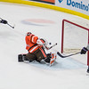 Minnesota State's Brad McClure (left) takes a one-timer against Bowling Green's goalie Eric Dop after getting a pass from Daniel Brickley (8) in the first period of Friday's game played at the Verizon Center. McClure's shot was deflected by Dop's stick, however, the Mavericks poured on the offense and won 6-1. Photo by Jackson Forderer