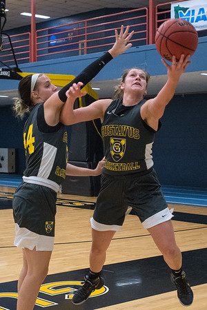 Miranda Rice of Gustavus puts up a scoop shot while being defended by teammate Paige Richert during practice on Thursday. Photo by Jackson Forderer
