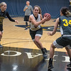 Miranda Rice (center) of Gustavus drives the lane during a drill in practice on Thursday. Rice is a senior forward for the Gusties and was named MIAC All-Conference last season. Photo by Jackson Forderer