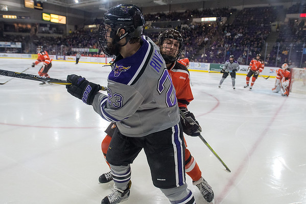 Minnesota State's Nicholas Rivera (23) takes a hit from Bowling Green's Lukas Craggs in the second period of Friday's game. The Mavericks capitalized on power plays and won 6-1. Photo by Jackson Forderer