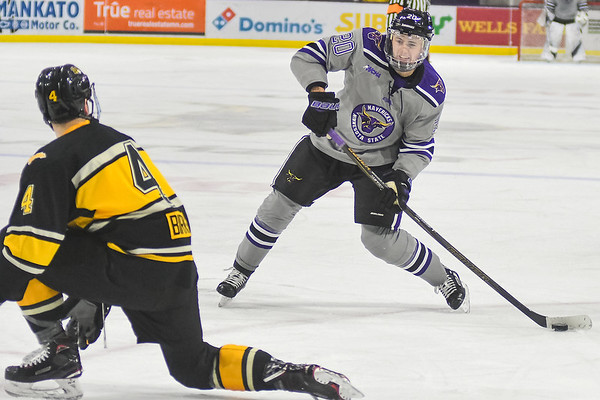 Minnesota State's Marc Michaelis takes a shot while being defended by Michigan Tech's Dane Birks (4) in a game played at the Verizon Center on Oct. 28. Photo by Jackson Forderer