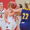 Emily Skrien of Bethany Lutheran fights for a loose ball with St. Catherine's Katie Benjamin in the first half of Tuesday's game. Bethany came back from a fourth quarter deficit to win the game and remain undefeated. Photo by Jackson Forderer