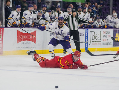 Minnesota State's Nicholas Rivera (center) watches his shot go in to an empty net past a diving Marshall Moise of Ferris State in the third period of Saturday's game, as the Mavericks put the finishing touches on a series sweep of the Bulldogs. Photo by Jackson Forderer