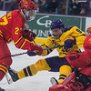 Minnesota State's Charlie Gerard tries to find the puck underneath him while crashing the net against Ferris State's goalie Roni Salmenkangas and defensemen Zac Tierney in the second period of action in Friday's WCHA game. Photo by Jackson Forderer