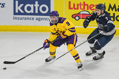 Charlie Gerard of Minnesota State looks to pass to a teammate while being defended by Mount Royal University's Jesse Lees during a game played on Oct. 6 at the Verizon Center. Photo by Jackson Forderer