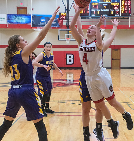 Bethany Lutheran's Haley Sandin (right) goes up for a shot over St. Catherine's Sam Orth in the fourth quarter of Tuesday's game. Photo by Jackson Forderer