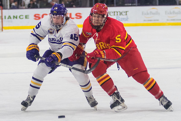 Julian Napravnik of Minnesota State (left) fights for control of the puck while being defended by Ferris State's Justin Smith in the second period of Saturday's WCHA game played at the Verizon Center. Photo by Jackson Forderer