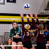WEM's Outside Hitter Kate Masberg hits the ball past Springfield's Alyssa Streich and McKensie Schwanke Thursday night during the 2A Sub-Section Volleyball Tournement at East High School. Photo By Levi Janssen