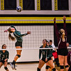 WEM's Right Side Hitter MaeLea Harmon prepares to spike the ball Thursday night during first set of the Section 2A Sub-Section Volleyball Tournament at East High School.