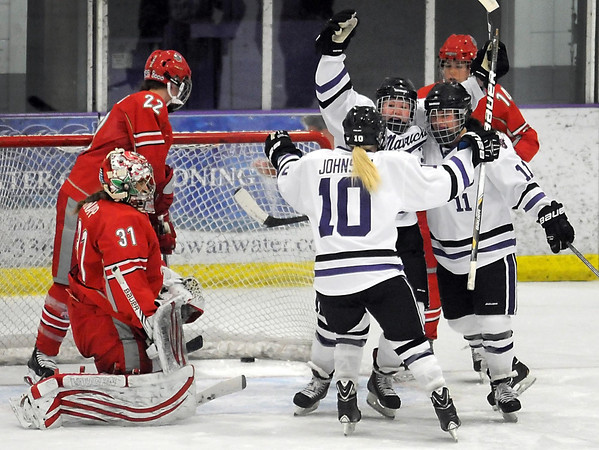 Pat Christman<br /> Minnesota State and former Mankato East/Loyola standout Savannah Quandt (center) celebrates her first collegiate goal with teammates Katie Johnson (10) and Natalie Stoltz (11) during the first period against Ohio State Friday at All Seasons Arena.