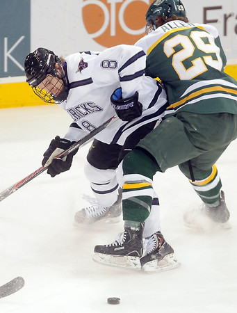 Pat Christman<br /> Minnesota State's Max Gaede and University of Alaska-Anchorage's Scott Allen get twisted up while chasing the puck during the first period Friday at the Verizon Wireless Center.