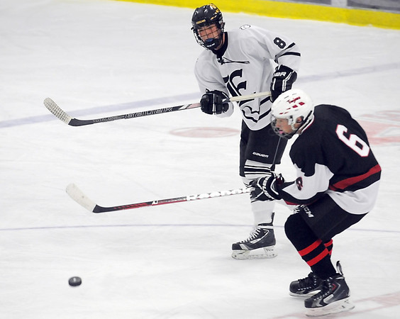 Pat Christman<br /> Mankato East/Loyola's Shane Sellner passes the puck during a game against Worthington Thursday at All Seasons Arena.