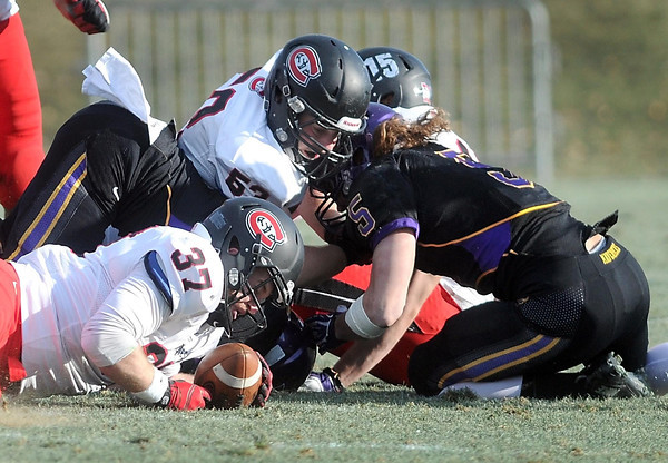 Pat Christman<br /> St. Cloud State's Kyle Risinger (37) recovers a second half fumble by Minnesota State's Connor Thomas Saturday.