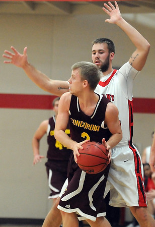 Pat Christman<br /> Bethany Lutheran College's Mitchell Olson defends Concordia Chicago's Joel Kosberg during the first half Saturday.