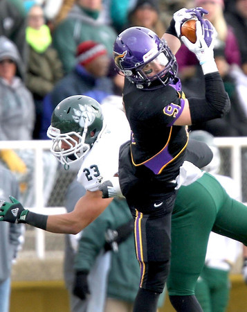 Minnesota State's Adam Thielen leaps over Northwest Missouri State's Clarke Snodgrass for a catch during the second half of their NCAA Division II Super Regional tournament game Saturday at Blakeslee Stadium.