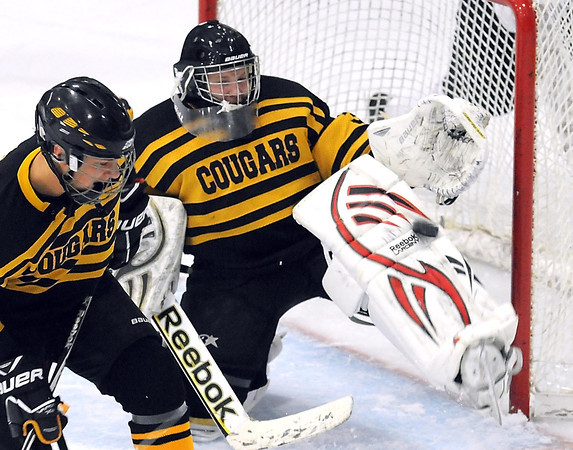 Mankato East/Loyola goalie Jeremia Merela makes a save during the first period against Mankato West Thursday at All Seasons Arena.