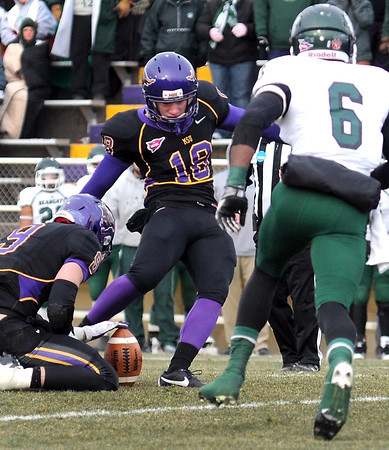 Northwest Missouri State's Travis Manning can't get into the backfield before Minnesota State kicker Sam Brockshus kicks the game winning field goal in the second overtime of their NCAA Division II Super Regional tournament game Saturday at Blakeslee Stadium.