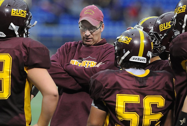 Buccaneers coach Randy Kuechenmeister confers with players during a time-out.