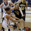 Lady Mavericks Lexie Ulfers and Jameila Hudnell (lower left) and Gusties Abby Rothenbuehler (34) and Karina Schroeder scramble for a loose ball during first period action.