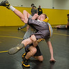 Chase Groh wrestles against Spencer Ruedy during practice at Mankato East on Wednesday. Groh will be competing in the 106-pound division this year for the Cougars. Photo by Jackson Forderer