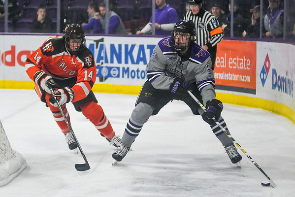 Minnesota State's Jake Jaremko (right) skates with the puck behind the net while being chased by Bowling Green's Justin Wells during a game played at the Verizon Center on Nov. 11. Photo by Jackson Forderer
