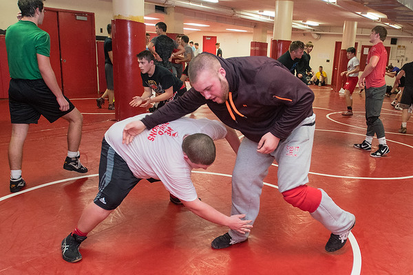 Mankato West's Seth MacDonald (right) grapples with teammate Matt Pipes during wrestling practice held on Tuesday. MacDonald will be wrestling in the heavyweight division this season. Photo by Jackson Forderer