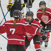 Mankato West's Lindsey Hays (center) celebrates with Courtney Bloemke (7) after Hays assisted her on her first of three goals. Bloemke scored all three of West's goals, including the game-winning overtime goal to edge the Scarlets past the Cougars 3-2. Photo by Jackson Forderer