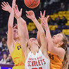 Mankato East's Abby Grams (right) goes up for a rebound in the Cougars game against Mankato West played on Dec. 21, 2017. Photo by Casey Ek