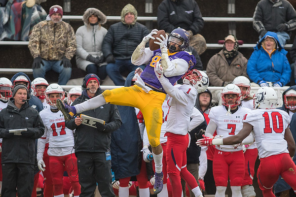 Minnesota State's Shane Zylstra makes a leaping catch over Colorado State - Pueblo's Emery Taylor in front of the Pueblo bench in the first half of Saturday's playoff game played at Blakeslee Stadium. Zylstra had four catches for 90 yards in the Mavericks win. Photo by Jackson Forderer