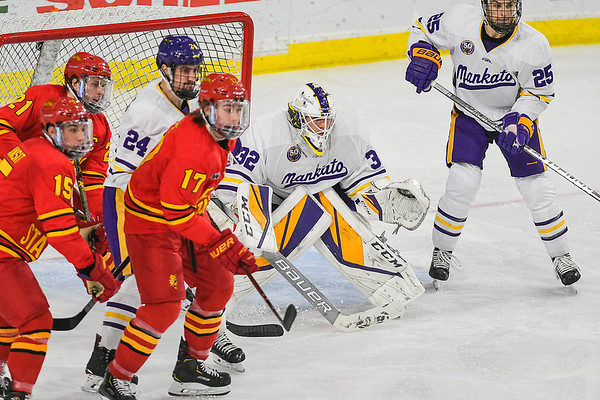 Minnesota State goalie Mathias Israelsson (center) keeps his eye on the puck during Saturday's game against Ferris State. Photo by Jackson Forderer